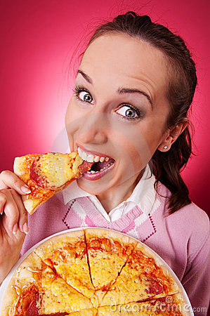 Happy woman eating piece of pizza