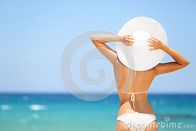 Happy woman enjoying beach relaxing in summer