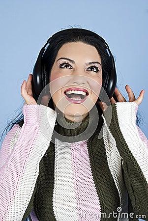 Happy woman enjoying music in headphones