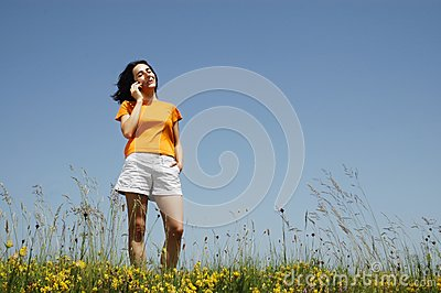Happy woman enjoying the outdoors using her cell p