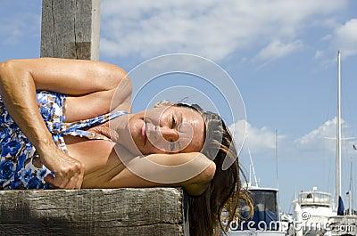 Happy Woman enjoying sunny day at Marina