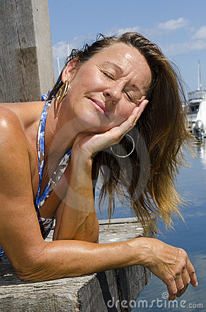 Happy Woman enjoying sunny day at Marina