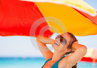 Happy woman enjoying vacation on beach