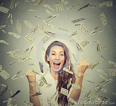 Free Happy Woman Exults Pumping Fists Ecstatic Celebrates Success Under A Money Rain Stock Photography - 64709992