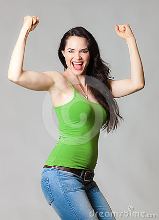 Happy woman flexing muscles