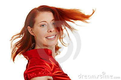 Happy woman with flying red hair