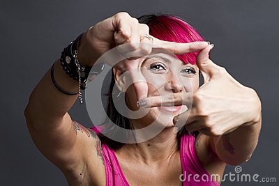 Happy woman framing face Stock Photo
