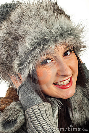 Happy woman in fur hat
