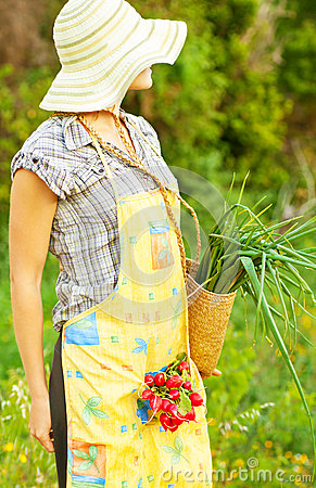Happy woman gardener working