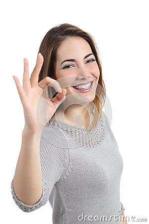 Happy woman gesturing ok