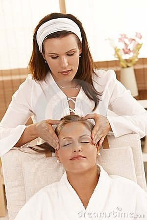 Happy woman getting head massage