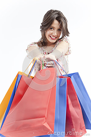 Happy woman giving shopping bags