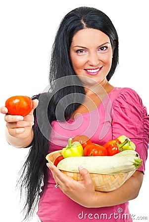 Happy woman giving tomato