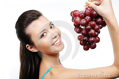 Happy woman with grapes