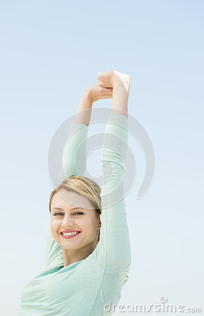 Happy Woman With Hands Raised Against Clear Sky