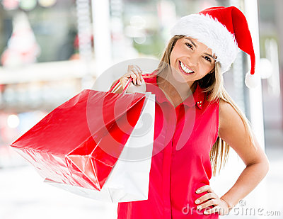 Happy woman with her Christmas purchases