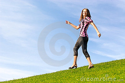 Happy woman on a hill