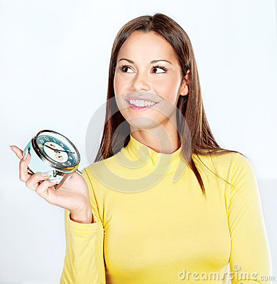 Happy woman holding alarm clock