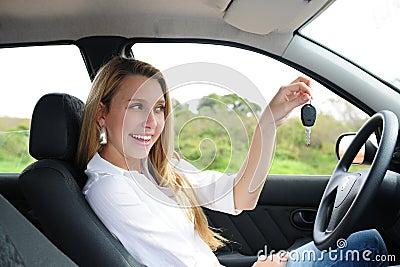 Happy woman holding car key