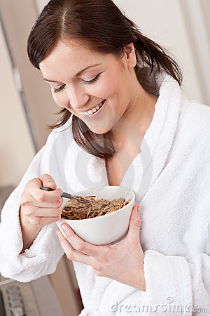 Happy woman holding cereals for breakfast