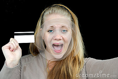 Happy woman holding a credit card