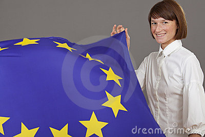 Happy woman holding european flag