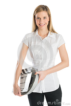 Happy Woman Holding Film Slate And Reel