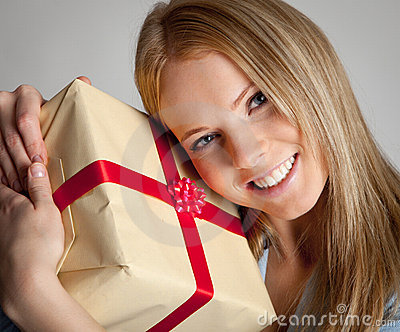 Happy woman holding gift box