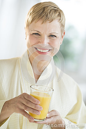Happy Woman Holding Glass Of Juice