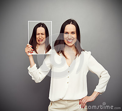 Free Happy Woman Holding Her Sad Picture Stock Images - 30414644