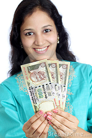 Happy woman holding  Indian currency notes