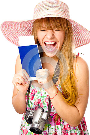Happy woman is holding a passport with ticket Stock Photo