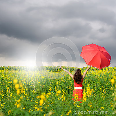 Happy woman holding red umbrella and raincloud