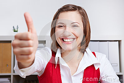 Happy woman holding thumbs up
