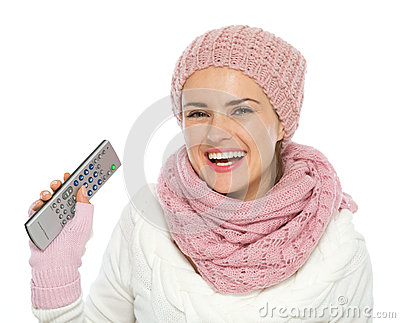 Happy woman holding TV remote control