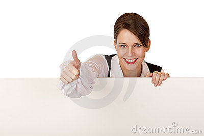 Happy woman holds blank billboard and shows thumb