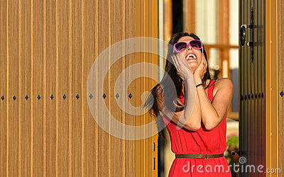 Happy woman in house entrance