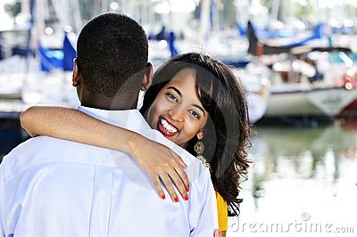 Happy woman hugging man