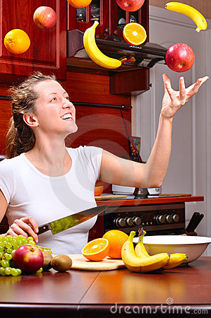 Free Happy Woman Is Cooking Fruit Salad Stock Photos - 16867803