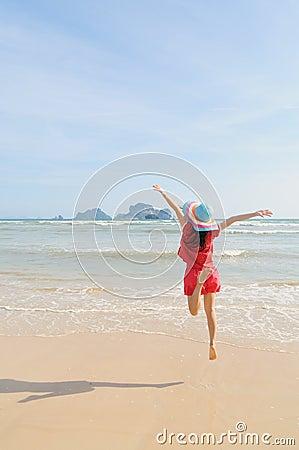 Happy woman Jump on the beach in Krabi Thailand