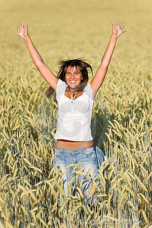 Happy woman jump in corn field in summer
