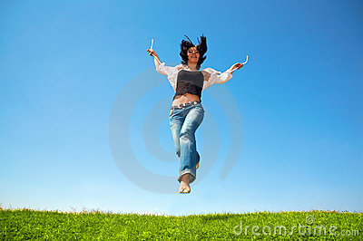 Happy woman jump in field