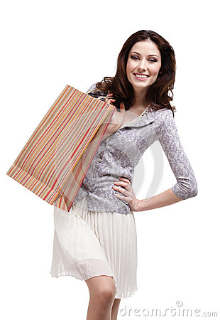 Happy woman keeps striped paper gift bag