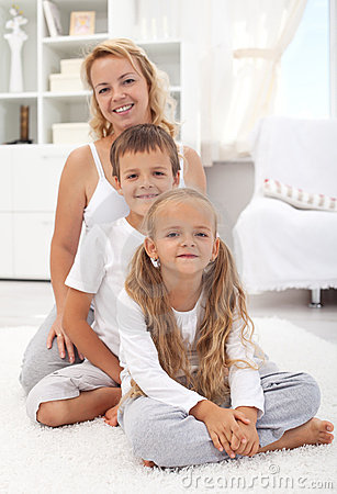 Happy woman and kids sitting in the living room