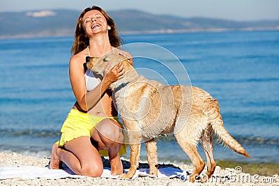 Happy woman with labrador