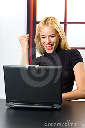 Happy woman on laptop