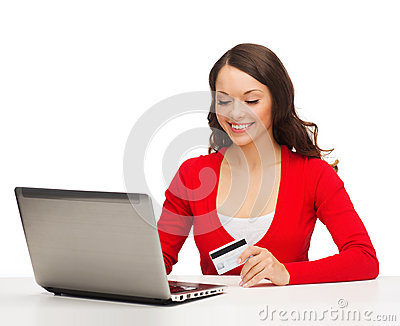 Happy woman with laptop computer and credit card