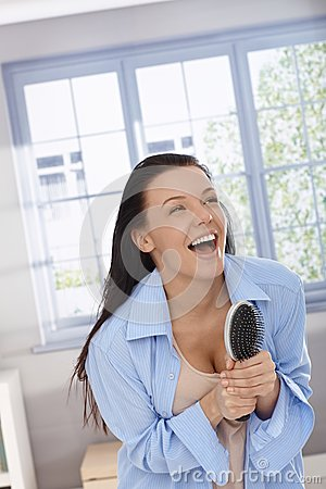 Free Happy Woman Laughing With Hairbrush In Hand Stock Photography - 25341042