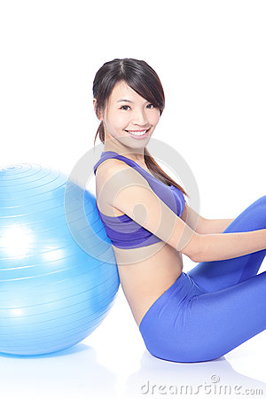 Happy woman leaning on a pilates ball