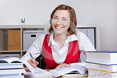 Happy woman learning at her desk